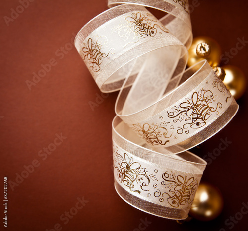 Tuinposter Boeddha Christmas gift ribbon and glass balls on brown background