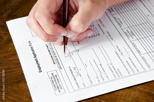 Fotografie, Obraz  Hand filling out job application