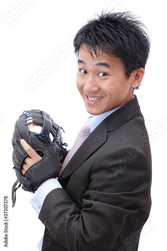 Fotografie, Obraz  Young Business Man pitching baseball