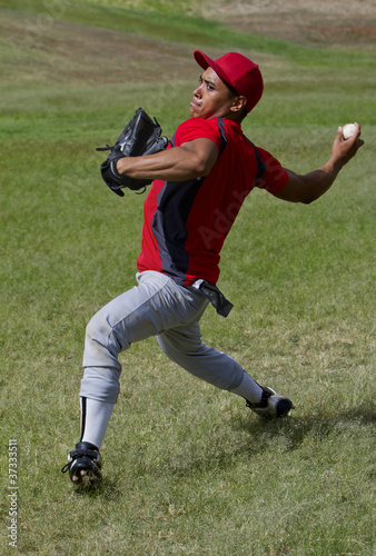 Fotografie, Obraz  Baseball player throws a ball
