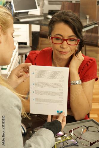 6d72899c8c15 Frau beim Optiker - Buy this stock photo and explore similar images ...