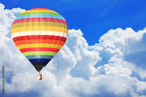 colorful hot air balloon on nice cloudy blue sky