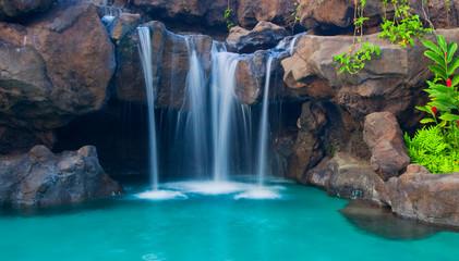 Fototapeta Wodospad Waterfall into Resort Pool