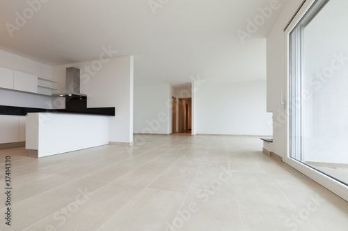 sala moderna con camino e cucina - Buy this stock photo and explore ...