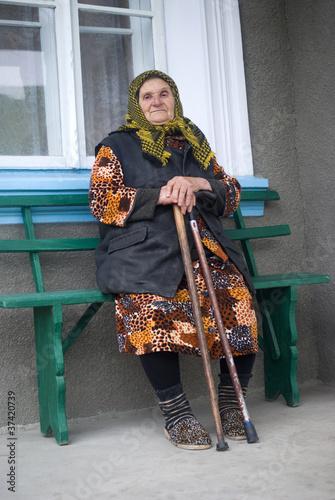 Fotografia  Poor elderly woman of Eastern Europe