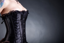 Close-up Shot Of Woman In Black Corset