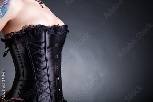 Obraz na płótnie Close-up shot of woman in black corset