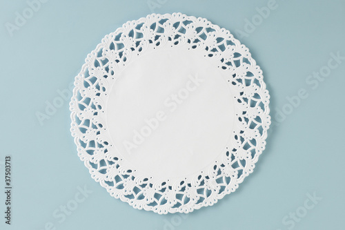 Valokuva  Circular doily on glass table