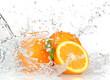Leinwandbild Motiv Orange fruits with Splashing water