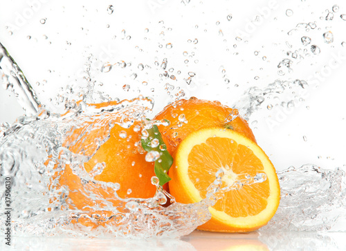 Photo Stands Splashing water Orange fruits with Splashing water