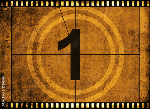 Photo  movie film strip with countdown number on grunge background