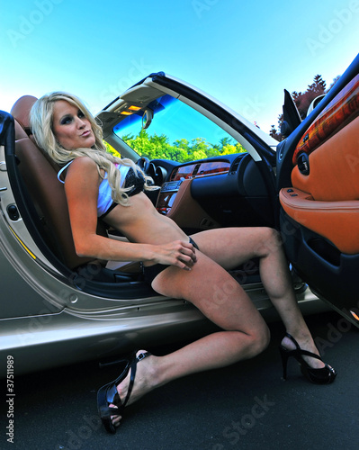 Fotografie, Obraz  Beautiful blond getting out of a car