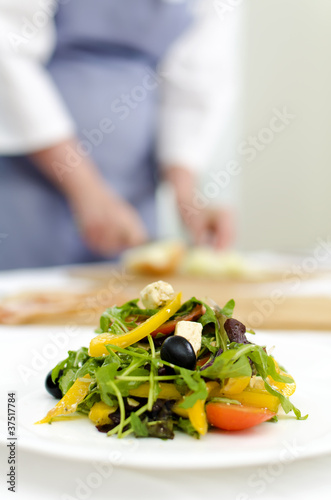 fresh Greek salad on white plate Poster