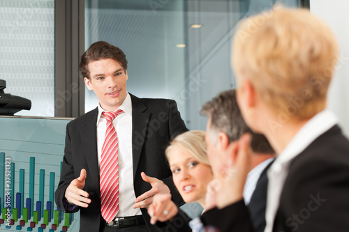 Fotografering  Business - Präsentation in einem Team