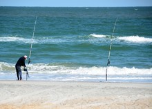 Lone Surf Fisherman On Uncrowded Beach Florida Usa