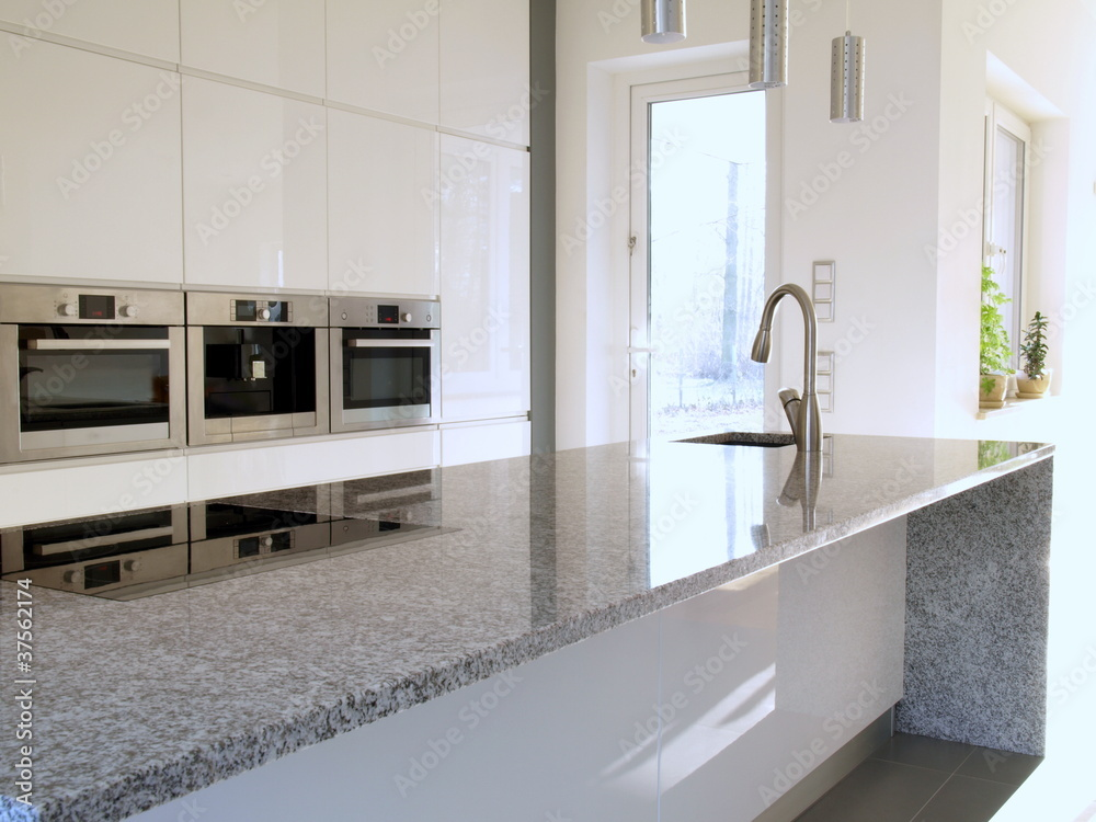 Fototapeta Granite countertop in a modern kitchen