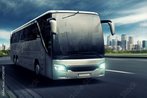 Bus in front of big City