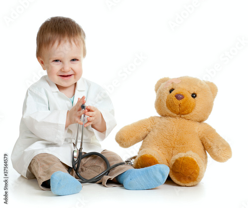 Adorable boy with clothes of doctor and teddy bear over white #37564579