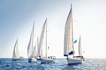 Fototapeta na wymiar Sailing ship yachts with white sails