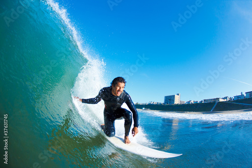 Foto  Surfer on Amazing Blue Ocean Wave