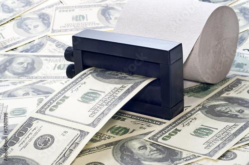 Fotografija machine print money out of toilet paper