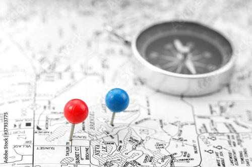 Fototapeta Pins and compass on black and white map obraz na płótnie