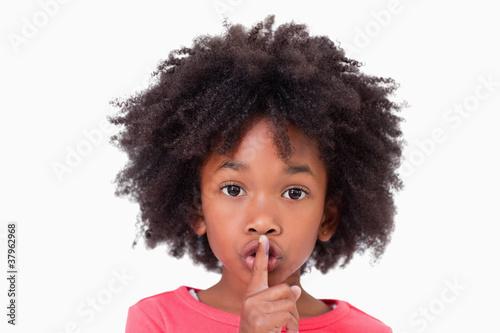 Fotografie, Obraz  Close up of a girl asking silence