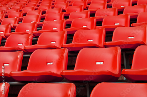 Papiers peints Stade de football Red Empty plastic seats at stadium
