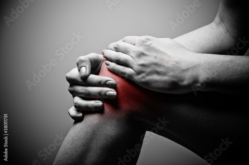Fotografiet  Young woman having knee pain