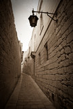 Retro photo of  narrow town street - 38069763