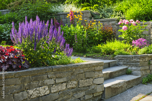 Foto op Canvas Tuin Garden with stone landscaping