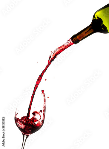 Photo Wine pouring from bottle into glass