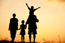 Children With Mother And Father, Family At Sunset