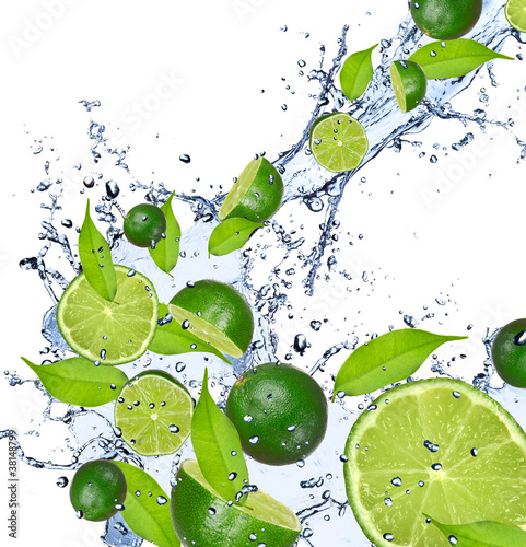 Ingelijste posters Opspattend water Limes falling in water splash, isolated on white background