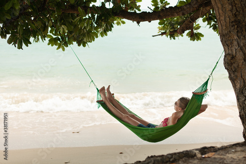 Wall Murals Bali View nice woman lounging in hammock in tropical environment