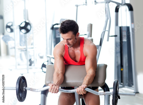 Spoed Foto op Canvas Fitness man with weight training equipment on sport gym