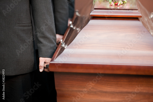 coffin bearer carrying casket at funeral Wallpaper Mural