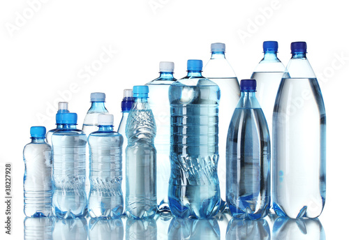 Fotografia  Group plastic bottles of water isolated on white