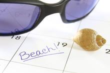 Closeup Of A Calendar With Beach Text