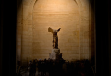 Crowds Around Winged Victory Sculpture