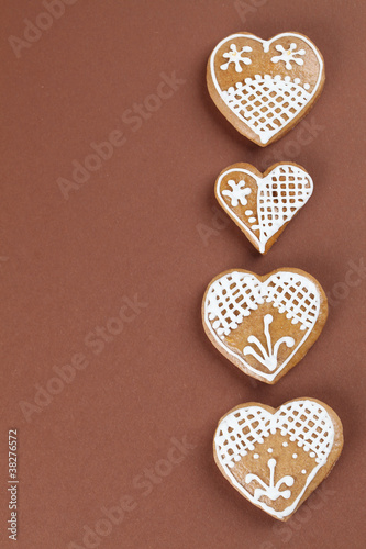 Gingerbread Hearts On Brown Background Buy This Stock Photo And