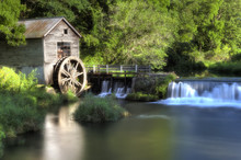 Antique Water Wheel And Dam On River