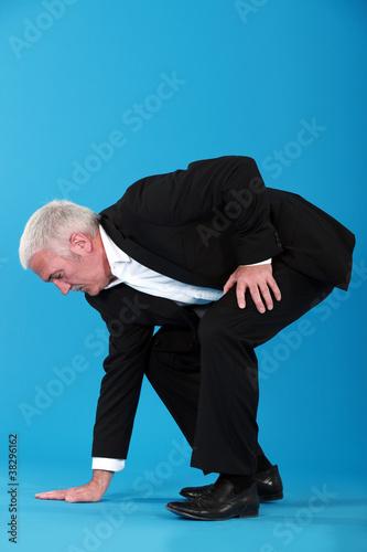 Fotografie, Obraz  Man touching the floor