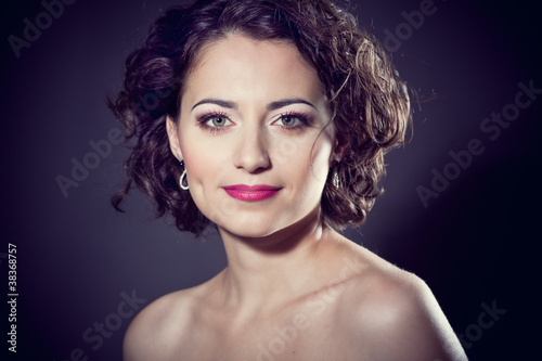 Face of a beautiful brunette girl with curly hair Canvas-taulu