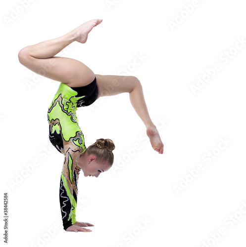 Spoed Foto op Canvas Gymnastiek Young professional gymnast stand on splits