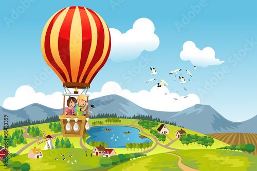 Photo  Kids riding hot air balloon