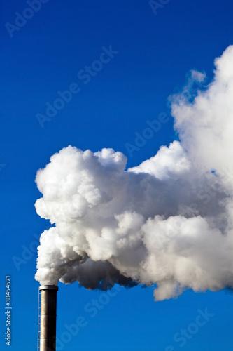 Fotografie, Obraz  rauchende Schlote einer Fabrik