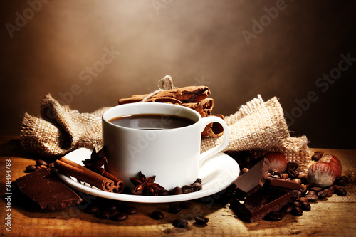 Photo Stands Coffee beans coffee cup and beans, cinnamon sticks, nuts and chocolate