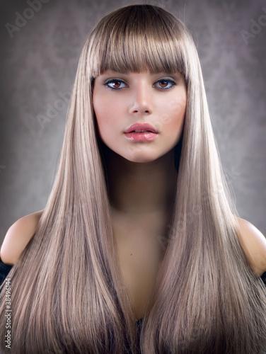 Obraz na plátně  Beautiful Girl with Blond Hair. Healthy Long Hair