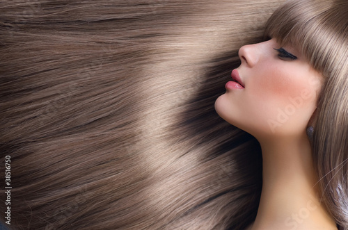 Fotografie, Obraz  Beautiful Girl with Blond Hair. Healthy Long Hair